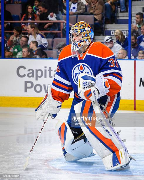 Richard Bachman of the Edmonton Oilers defends net against the Toronto Maple Leafs during an NHL game on October 2013 at Rexall Place in Edmonton AB...