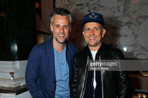 Richard Bacon and Marc Quinn attend a preopening dinner hosted by Kate Bryan at Zobler's Delicatessen at The Ned London on April 25 2017 in London...