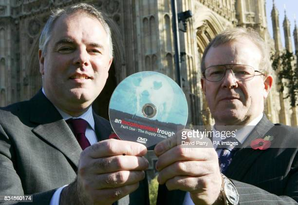 Richard Bacon MP and Richard Longthorp a farmer from East Yorkshire holding a a DVD copy of the film An Inconvenient Trough part of a documentary...