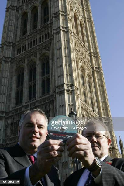 Richard Bacon MP and Richard Longthorp - a farmer from East Yorkshire - holding a a DVD copy of the film, An Inconvenient Trough - part of a...
