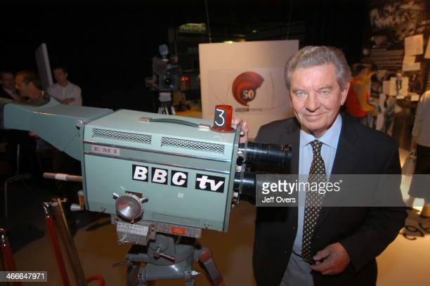 Richard Baker faces a modern camera at an exhibition for BBC staff at TV Centre to celebrate 50 years of TV News