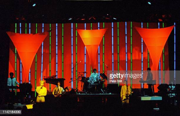 Richard Barbieri David Sylvian Mick Karn and Steve Jansen of Japan perform on stage with guitarist Masami Tsuchiya and Ryuichi Sakamoto of Yellow...