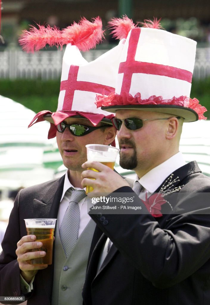 Richard Beastall and Paul Hughes wear patriotic hats as they
