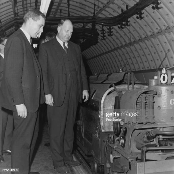Richard Beeching Chairman of the British Railways Board with Anthony Wedgwood Benn the Postmaster General at the General Post Office headquarters...