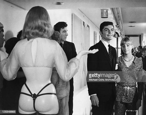 Richard Benjamin and Carrie Snodgress are not prepared for what they see at a Manhattan art gallery opening in a scene from the film 'Diary Of A Mad...