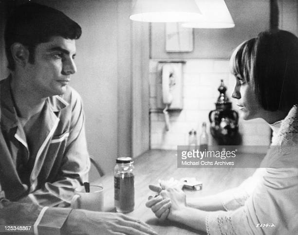 Richard Benjamin and Carrie Snodgress have a serious discussion about their married life in a scene from the film 'Diary Of A Mad Housewife' 1970