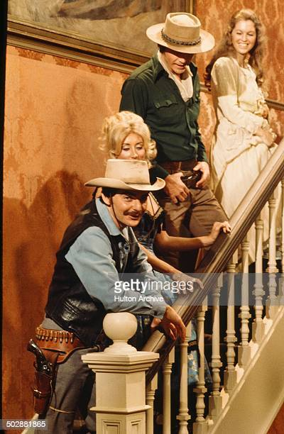 "Richard Benjamin and James Brolin walk upstairs with women robots in a scene from the MGM movie ""Westworld"" circa 1973."