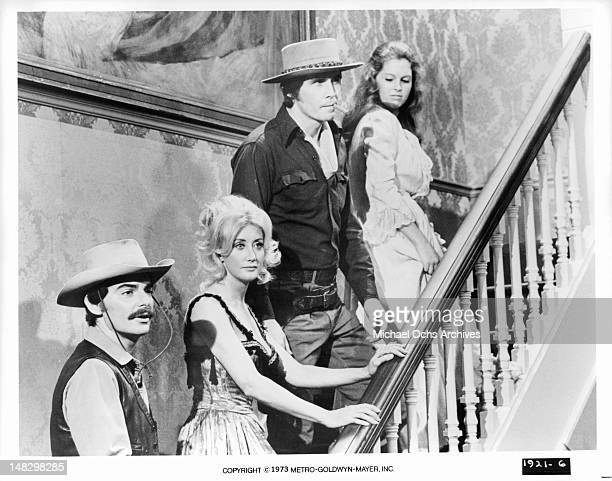 Richard Benjamin Linda Gaye Scott and James Brolin ascend the stairs to an evening of pleasure in a scene from the film 'Westworld' 1973