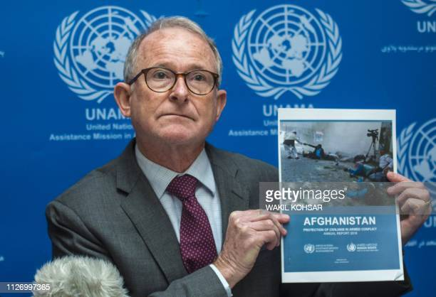 Richard Bennett head of the UN Assistance Mission in Afghanistan human rights unit holds up a copy of 'UN 2018 Annual Report on the Protection of...
