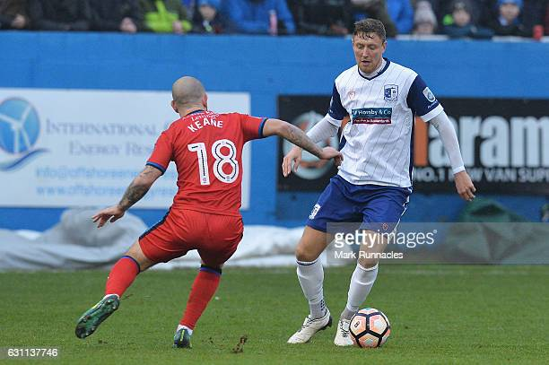 Richard Bennett of Barrow and Keith Keane of Rochdale compete for the ball during the Emirates FA Cup third round match between Barrow FC and...