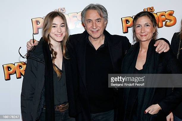 Richard Berry Between his daughters and agents Josephine and Coline attend 'Les Profs' Movie Premiere at Le Grand Rex on April 9 2013 in Paris France