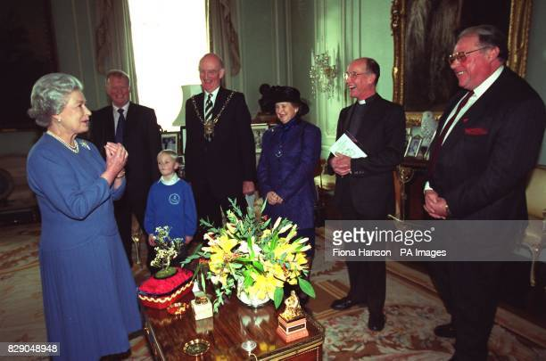Richard Biddlecombe with his son Sebastion with Councillor Edward James Mayor of Glastonbury and his wife Jane James and Reverand Patrick Riley the...