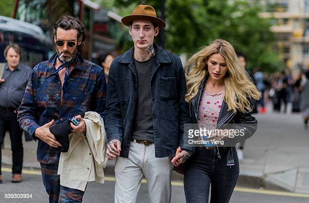 Richard Biedul and couple Dan Crowe and Ruby Quilter outside Oliver Spencer during The London Collections Men SS17 on June 10 2016 in London England