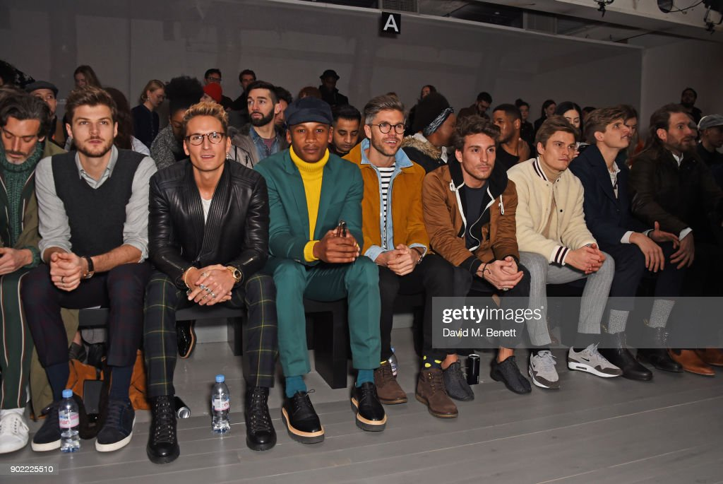 Richard Biedul, Jim Chapman, Oliver Proudlock, Eric Underwood, Darren Kennedy, Deano Bugatti, Oliver Cheshire, Toby Huntington-Whiteley and Craig McGinlay attend the Christopher Raeburn show during London Fashion Week Men's January 2018 at BFC Show Space on January 7, 2018 in London, England.