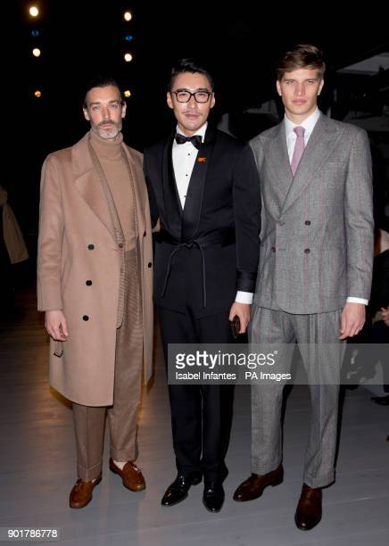 Richard Biedul, left, Hu Bing and Toby Huntington-Whiteley on the front row during the John Lawrence Sullivan Autumn/ Winter 2018 London Fashion Week...