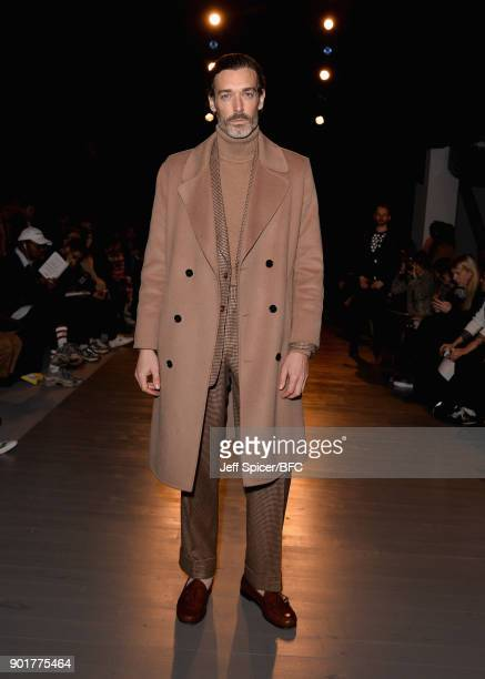 Richard Biedul poses on the front row at the John Lawrence Sullivan show during London Fashion Week Men's January 2018 at BFC Show Space on January...