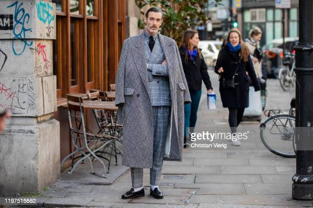 Richard Biedul seen wearing grey wool coat black tie checkered grey suit outside Jordan Luca during London Fashion Week Men's January 2020 on January...