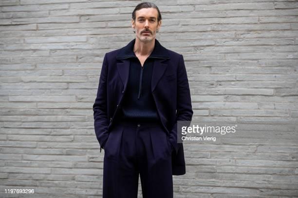 Richard Biedul seen wearing navy pants and jacket outside Chalayan during London Fashion Week Men's January 2020 on January 05, 2020 in London,...