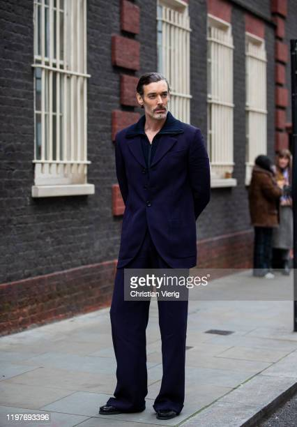 Richard Biedul seen wearing navy pants and jacket outside Chalayan during London Fashion Week Men's January 2020 on January 05 2020 in London England