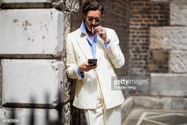 Richard Biedul weairng creme white suit is seen during London Fashion Week Men's June 2018 on June 9 2018 in London England