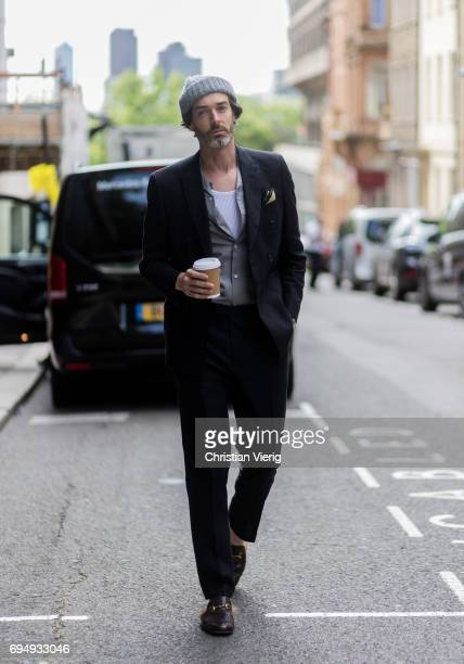 Richard Biedul wearing beanie suit Gucci slippers during the London Fashion Week Men's June 2017 collections on June 11 2017 in London England