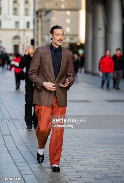 Richard Biedul wearing brown blazer black button shirt rust brown pants seen outside Edward Crutchley during London Fashion Week Men's January 2020...