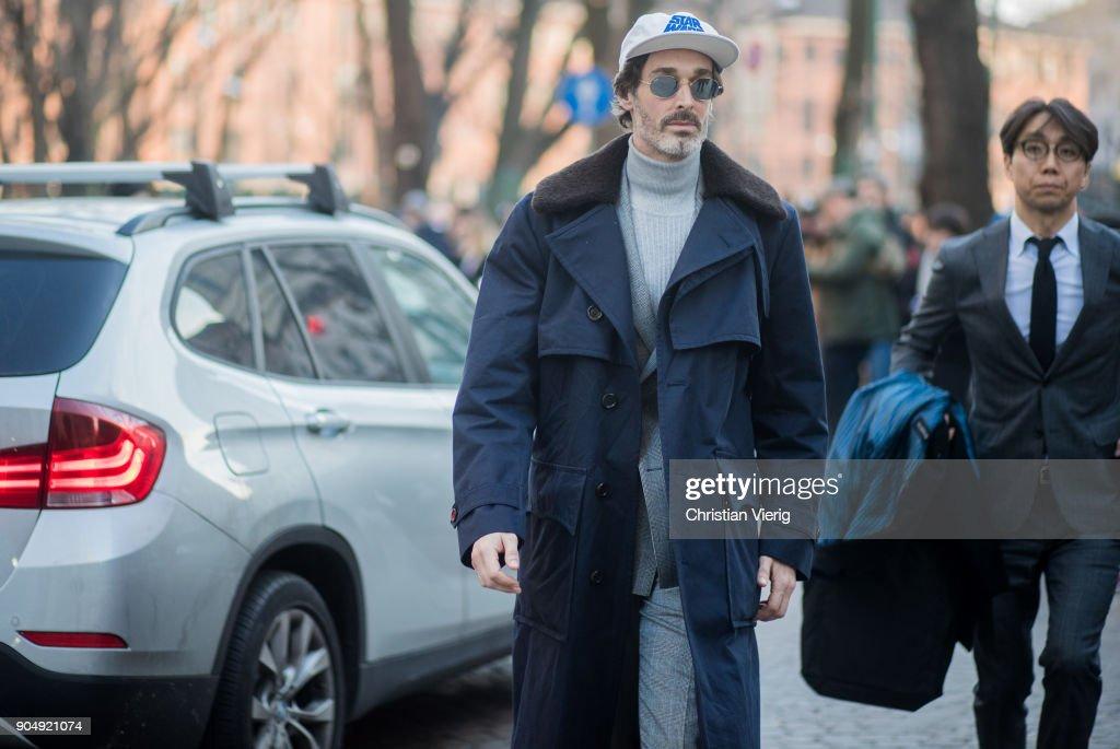 Richard Biedul wearing cap, turtleneck, navy coat is seen outside Daks during Milan Men's Fashion Week Fall/Winter 2018/19 on January 14, 2018 in Milan, Italy.