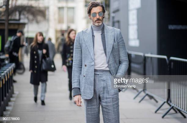Richard Biedul wearing grey suit during London Fashion Week Men's January 2018 on January 7 2018 in London England