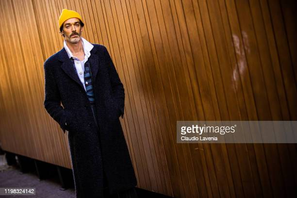 Richard Biedul wearing pinstripe suit and yellow beanie is seen at Fortezza Da Basso on January 08 2020 in Florence Italy