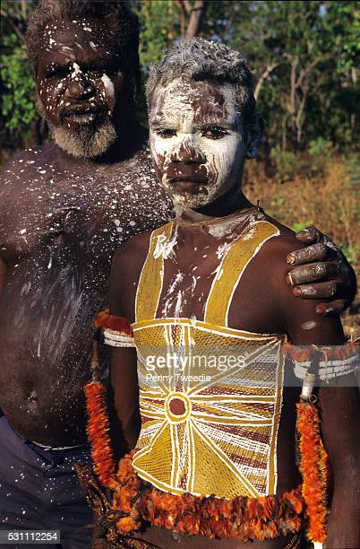 Richard Birrin Birrin with his son Jazmin painted with his clan Dreaming in preparation for his initiation ceremony Yathalamarra central Arnhem Land