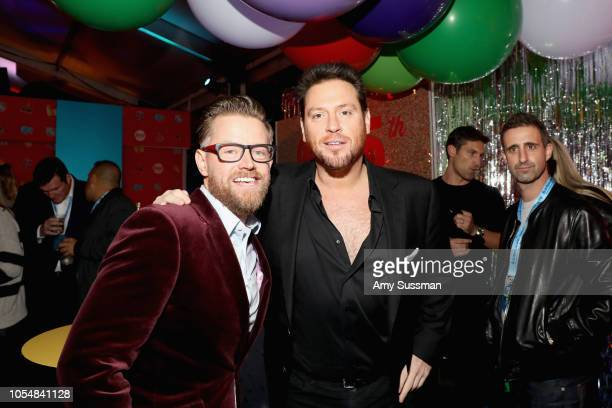 Richard Blais and Scott Conant attend Food Network's 25th Birthday Party Celebration at the 11th annual New York City Wine Food Festival at Pier 92...