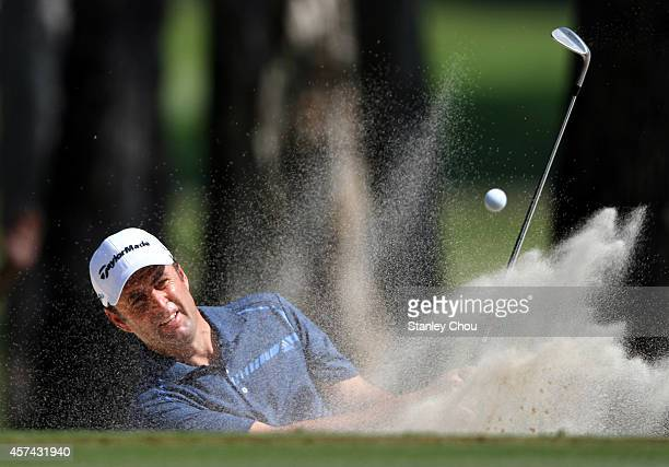 Richard Bland of England plays a bunker shot on the 9th hole during the 3rd round of the 2014 Hong Kong open at The Hong Kong Golf Club on October 18...