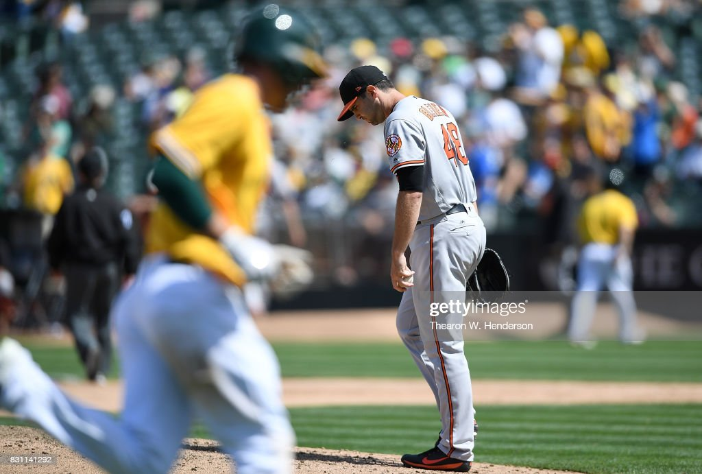 Richard Bleier #48 of the Baltimore Orioles walks back up on the mound with a new ball after giving up a two-run homer to Matt Joyce #23 of the Oakland Athletics in the bottom of the seventh inning at Oakland Alameda Coliseum on August 13, 2017 in Oakland, California. The Athletics won the game 9-3.