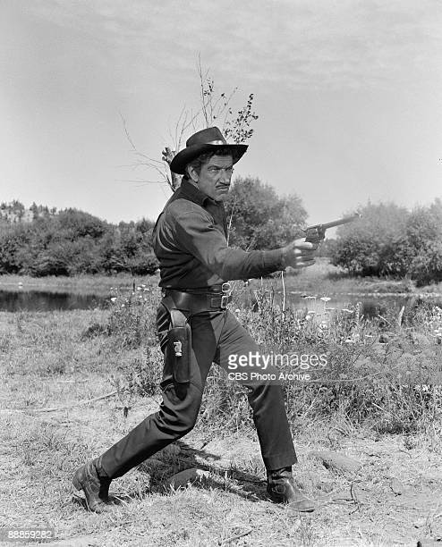 Richard Boone as Paladin draws his gun and shoots in the episode �Soledad Crossing� from the television series 'Have Gun Will Travel' August 9 1960