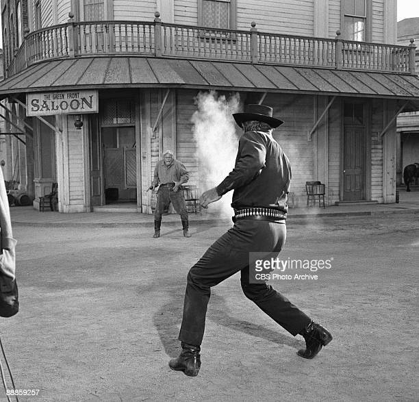Richard Boone as the gunslinger Paladin engages in a shootout outside a dusty western saloon from the television series 'Have Gun Will Travel' August...