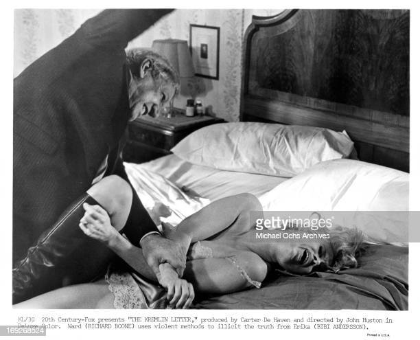 Richard Boone beating Bibi Andersson in a scene from the film 'The Kremlin Letter' 1970