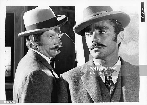 Richard Boone looking at Peter Lawford in a scene from the film 'Kangaroo' 1952