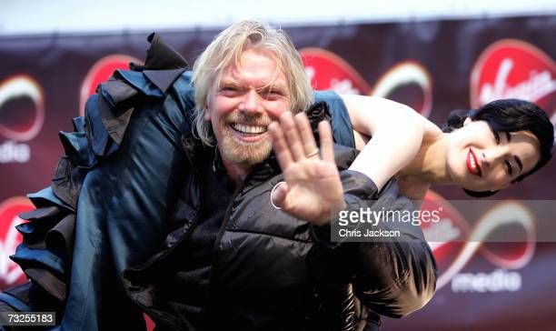 Richard Branson and Dita VonTeese launches Virgin Media at Convent Garden Market on February 8 2007 in London England Branson will spend the day in a...