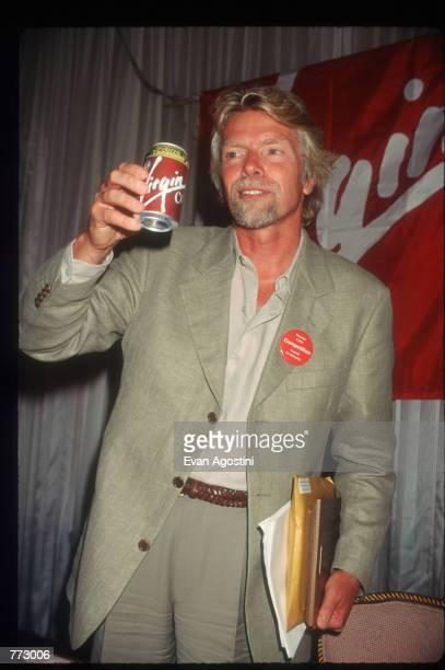Richard Branson, CEO of Virgin Atlantic Airways drinks Virgin Cola at The Wings Club September 11, 1996 in New York City. Branson discussed his...