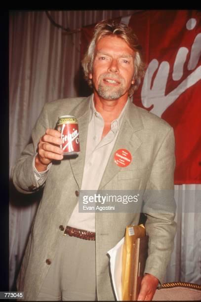 Richard Branson CEO of Virgin Atlantic Airways drinks Virgin Cola at The Wings Club September 11 1996 in New York City Branson discussed his...