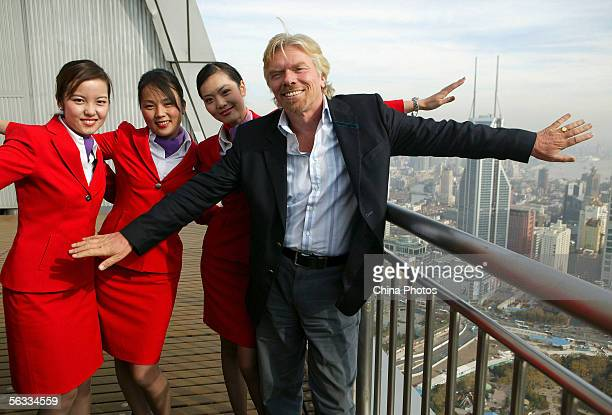 Richard Branson chairman and founder of the Virgin Group of companies poses for pictures with his employees during a press conference on December 5...