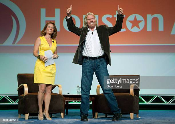 Richard Branson chairman and founder of Virgin Group Ltd arrives on stage to talk with journalist Alexis Glick left during the annual National...