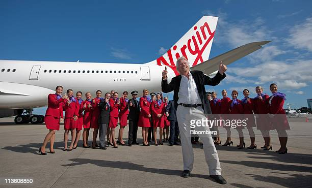 Richard Branson chairman and founder of Virgin Group Ltd front poses for the media after arriving in an A330 passenger jet for the unveiling of the...
