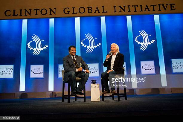 Richard Branson chairman and founder of Virgin Group Ltd right speaks as Neil deGrasse Tyson astrophysicist at the American Museum of Natural History...