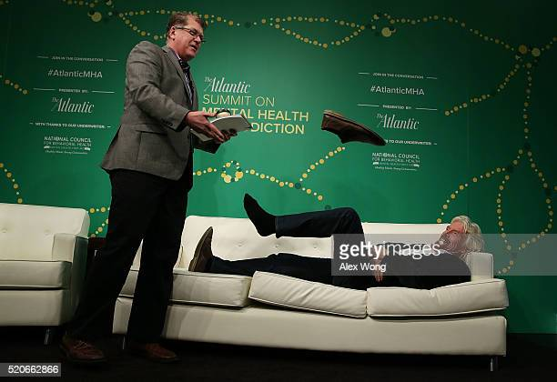 Richard Branson chairman of Virgin Airlines lies down on a couch and kicks off his shoe as he takes the stage during a discussion on 'The War on...