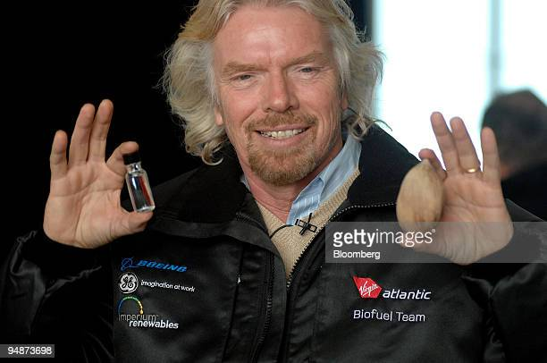 Richard Branson chairman of Virgin Group holds a jar of coconut oil and a babassu nut during a news conference at Heathrow International Airport in...