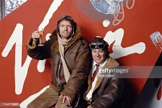 Richard Branson, co-founder of Virgin Atlantic Airways, left, in a leather flying jacket and helmet with his fellow co-founder of Virgin Atlantic...