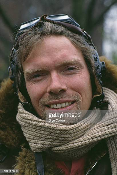 Richard Branson cofounder of Virgin Atlantic Airways poses in a leather flying jacket and helmet during a news conference to launch the airline at...