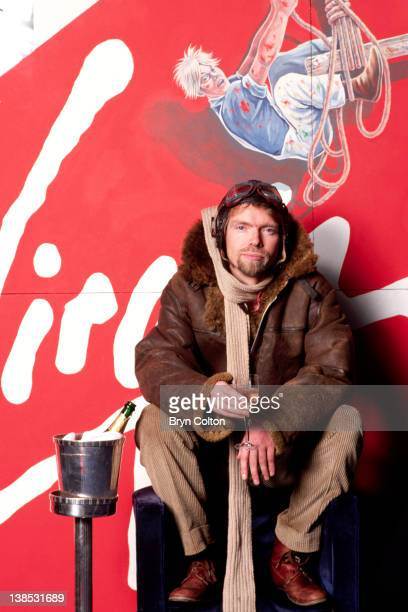 Richard Branson cofounder of Virgin Atlantic Airways poses in leather flying jacket and helmet during a news conference to launch the airline at...