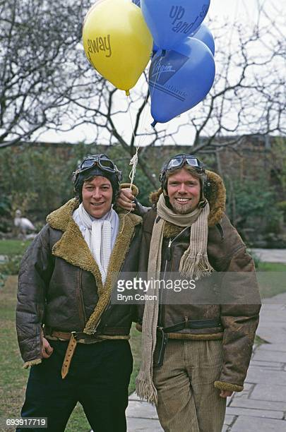 Richard Branson cofounder of Virgin Atlantic Airways right poses in a leather flying jacket and helmet with his fellow cofounder of Virgin Atlantic...